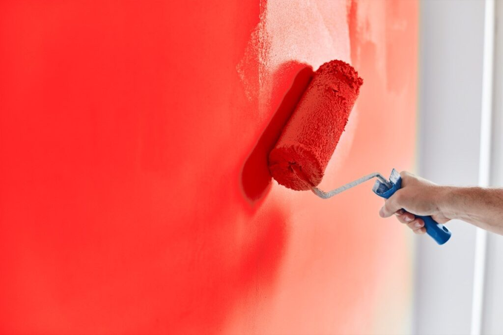 painting a red wall for red living room