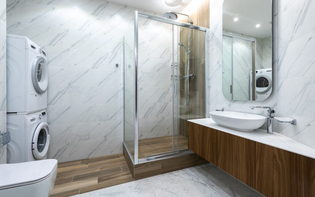 bathroom with white tile walls
